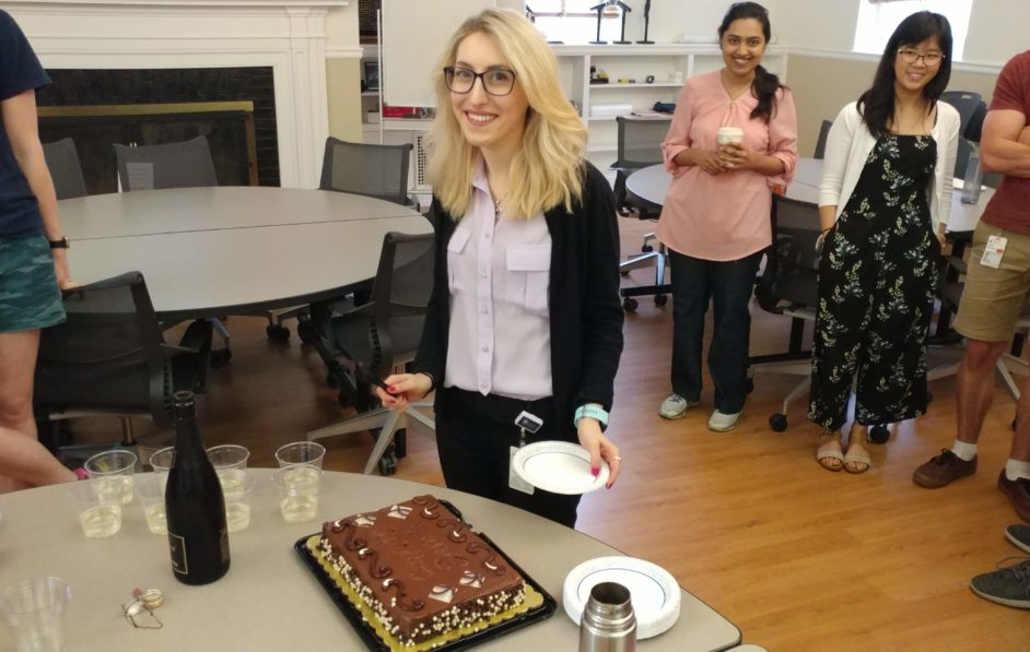 Sarah cutting her cake to celebrate her defense