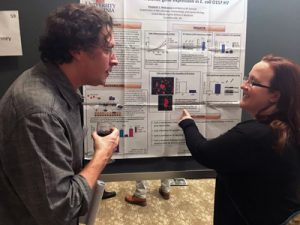 Beth and Chris discussing details of gene regulation (2017 Mid-Atlantic Microbial Pathogenesis Meeting)